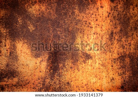 Grunge rusted metal texture. Rusty corrosion and oxidized background. Worn metallic iron rusty metal background Royalty-Free Stock Photo #1933141379