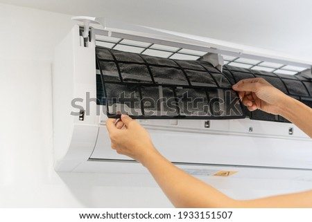 Dirty air conditioner filter need cleaning. Air conditioner service, repair and clean equipment. Royalty-Free Stock Photo #1933151507
