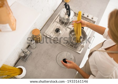 Kitchen. Close up picture of woman near the gas stove