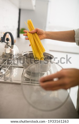 Spaghetti. Close up picture of womans hands holding spaghetti