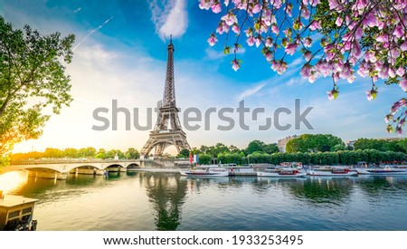 Paris Eiffel Tower and river Seine with sunrise in Paris, France. Eiffel Tower is one of the most iconic landmarks of Paris, web banner format ar early spring morning Royalty-Free Stock Photo #1933253495