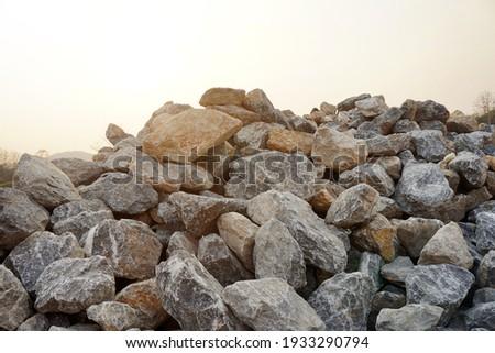 Piles of gravel limestone rocks on construction site. Break stones. Royalty-Free Stock Photo #1933290794