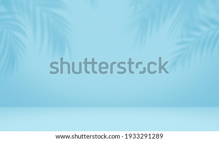 Empty palm shadow blue color texture pattern cement wall background. Used for presentation  business nature organic cosmetic products for sale shop online. Summer tropical beach with minimal concept Royalty-Free Stock Photo #1933291289