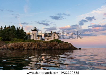 Rockport Harbor at sundown during a mid-summer boat ride through harbor. Royalty-Free Stock Photo #1933320686