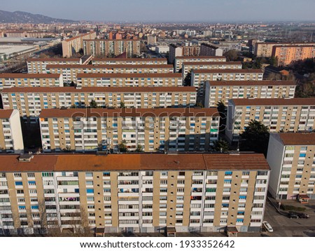 View from above a high-density residential neighborhood in industrial suburbs Royalty-Free Stock Photo #1933352642