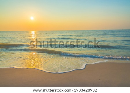 Sunrise on the beach - vintage filter. Sea waves lash line impact rock on the bea. Seaside under a rough sky. Royalty-Free Stock Photo #1933428932