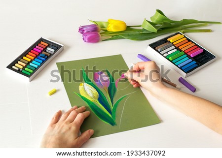 soft pastel drawing, painting of flowers. Pastel drawing tulips on paper, top view Royalty-Free Stock Photo #1933437092