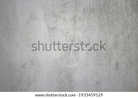 Dirty rough surface texture of sand screed cement wall with uneven stains and tiny holes. Royalty-Free Stock Photo #1933459529
