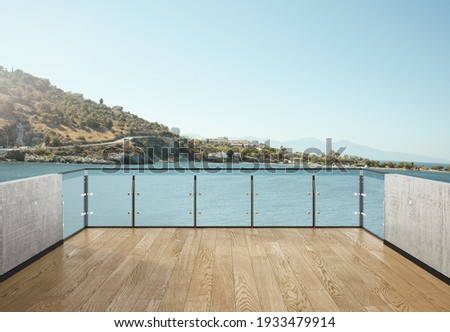 View from the balcony to the sea.Landscape. Sunny Day. Terrace with a beautiful view. Background with beautiful landscape. City near the sea. Royalty-Free Stock Photo #1933479914