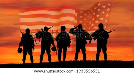 USA army soldier with nation flag. Greeting card for Veterans Day , Memorial Day, Independence Day . America celebration. Royalty-Free Stock Photo #1933556531