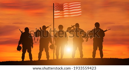 USA army soldier with nation flag. Greeting card for Veterans Day , Memorial Day, Independence Day . America celebration. Royalty-Free Stock Photo #1933559423