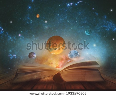 Book of the universe - opened magic book with planets and galaxies. Elements of this image furnished by NASA Royalty-Free Stock Photo #1933590803
