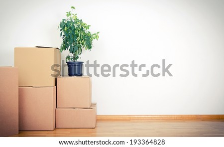 New home concept. Boxes in empty room.
