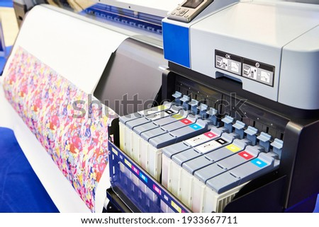 Sublimation printer for productive and quality printing of textiles and promotional items Royalty-Free Stock Photo #1933667711