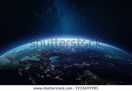 Surface of Earth planet in deep space. Outer dark space wallpaper. Night on planet with cities lights. View from orbit. Elements of this image furnished by NASA Royalty-Free Stock Photo #1933699985