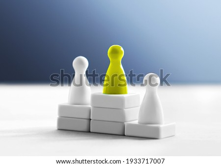 Victory, hierarchy and performance recognition concept. Winner on the first place on podium. The best competitor. Top three rank. One different and unique leader and champion in contest or competition Royalty-Free Stock Photo #1933717007