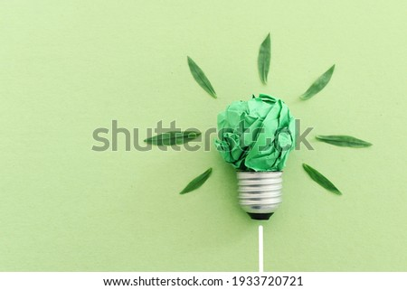 Concept image if green crumpled paper lightbulb, symbol of scr, innovation and eco friendly business Royalty-Free Stock Photo #1933720721