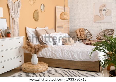 Stylish interior of bedroom with comfortable bed
