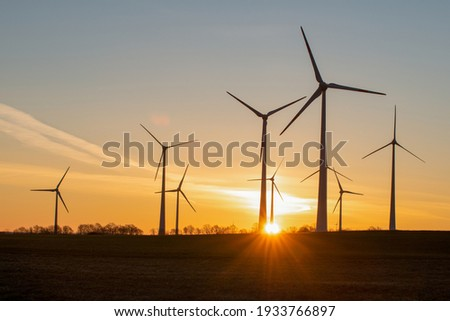 wind turbines in the rising sun Royalty-Free Stock Photo #1933766897