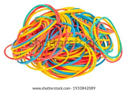 Many colourful multi coloured elastic rubber bands on white background. Studio Photo Royalty-Free Stock Photo #1933842089