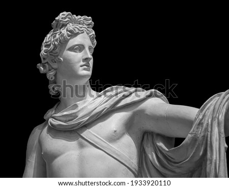 God Apollo bust sculpture. Ancient Greek god of Sun and Poetry Plaster copy of a marble statue isolated on black Royalty-Free Stock Photo #1933920110