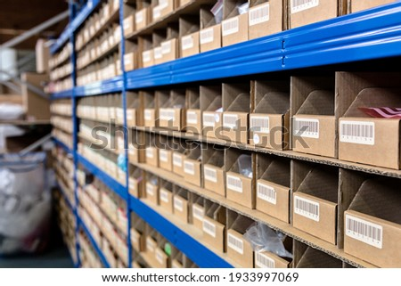 Up close view of pigeon holes used in a factory warehouse for storage of the raw materials. Warehouse, stores, storage, raw materials concept Royalty-Free Stock Photo #1933997069