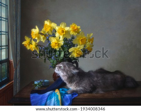 Still life with bouquet of spring flowers and curious kitty