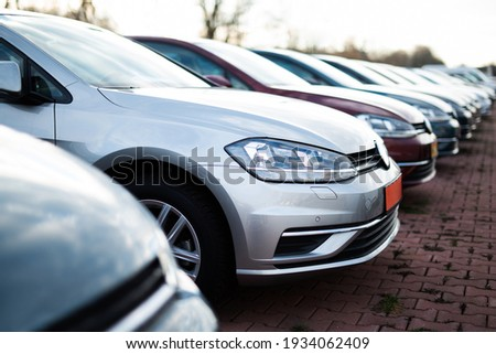 Cars in a row, automotive industry Royalty-Free Stock Photo #1934062409