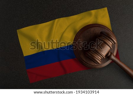 Judges gavel and the flag of Colombia. Law and Justice. Constitutional law.