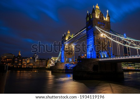 Towers of London, historical bridge of England illuminated in evening lights in London - UK Royalty-Free Stock Photo #1934119196