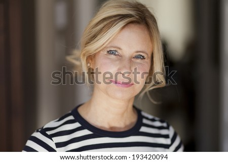 Mature woman smiling Royalty-Free Stock Photo #193420094