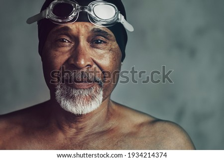 Senior African American swimmer, active at old age Royalty-Free Stock Photo #1934214374
