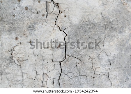 Cracked concrete. Concrete texture with cracks. Gray asphalt. The old texture is broken. Royalty-Free Stock Photo #1934242394