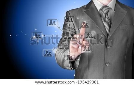 Businessman pressing modern social buttons #193429301