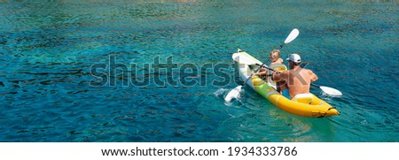 Family kayaking, father and son paddling in kayak on mediterranean sea canoe tour, having fun, outdoor activities with children in Greece Royalty-Free Stock Photo #1934333786