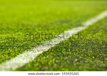 Close-up of artificial soccer pitch on a sunny day. Royalty-Free Stock Photo #193435265