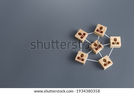 Blocks with businessmen connected by lines into a network team. Participation and assistance in a common project. Communication and feedback. An efficient small optimal compact business team. Royalty-Free Stock Photo #1934380358