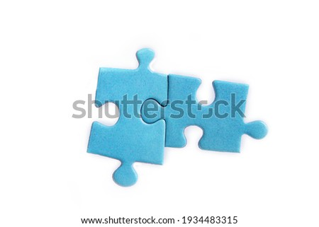 Puzzles on a white background. Solution and teamwork concept Royalty-Free Stock Photo #1934483315