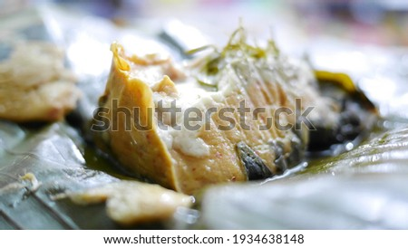 Mok steamed traditional Thai food It is a mixture of curry paste, coconut milk, fish meat and yor leaves, wrapped in banana leaves and steamed to cook