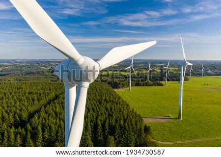 Windmill in a rural area during sunset Royalty-Free Stock Photo #1934730587