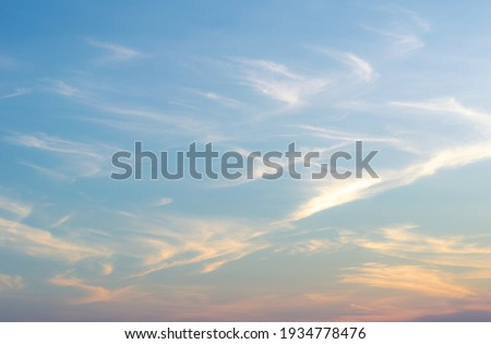 Beautiful Vivid sky painted by the sun leaving bright golden shades.Dense clouds in twilight sky in winter evening.Image of cloud sky on evening time.Evening Vivid sky with clouds. Royalty-Free Stock Photo #1934778476