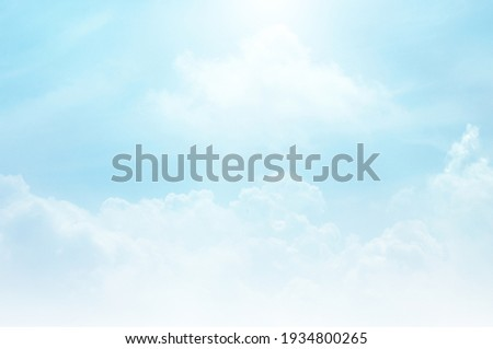 Blue sky with white cloud. Blue background. The summer sky is colorful clearing day and beautiful nature in the morning. for backdrop decorative and wallpaper design. The perfect sky background. Royalty-Free Stock Photo #1934800265
