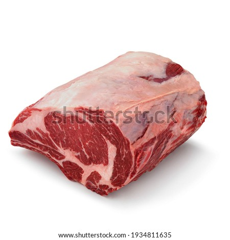 Close-up view of fresh raw Rib Eye Roast Bone In Ribs cut in isolated white background Royalty-Free Stock Photo #1934811635