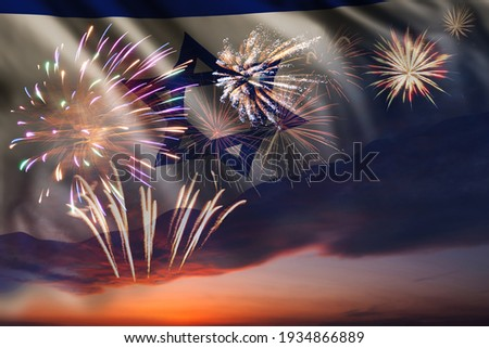 Holiday night sky with fireworks and flag of Israel for Independence day Royalty-Free Stock Photo #1934866889