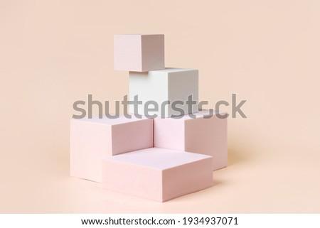 Geometric shapes podium for product display. Monochrome platform on pink background. Stylish background for presentation. Minimal style. Royalty-Free Stock Photo #1934937071