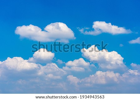 Cumulus white clouds floating on blue sky in beautiful morning Royalty-Free Stock Photo #1934943563