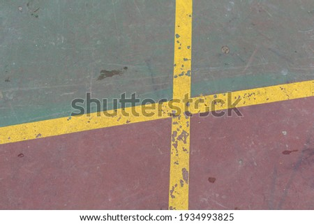 image of an outdoor basketball court. worn basketball court lines and floor. close up basketball court texture Royalty-Free Stock Photo #1934993825