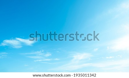 Blue sky and white clouds backdrop in the air panorama abstract style. Royalty-Free Stock Photo #1935011342