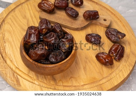 Dry date in a bowl. Ramadan Kareem with dates selective focus Royalty-Free Stock Photo #1935024638