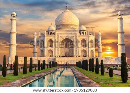 Taj Mahal at sunset, famous place of visit, India, Agra Royalty-Free Stock Photo #1935129080